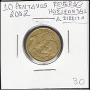 2002 - 10 Centavos, reverso horizontal 45o à direita.